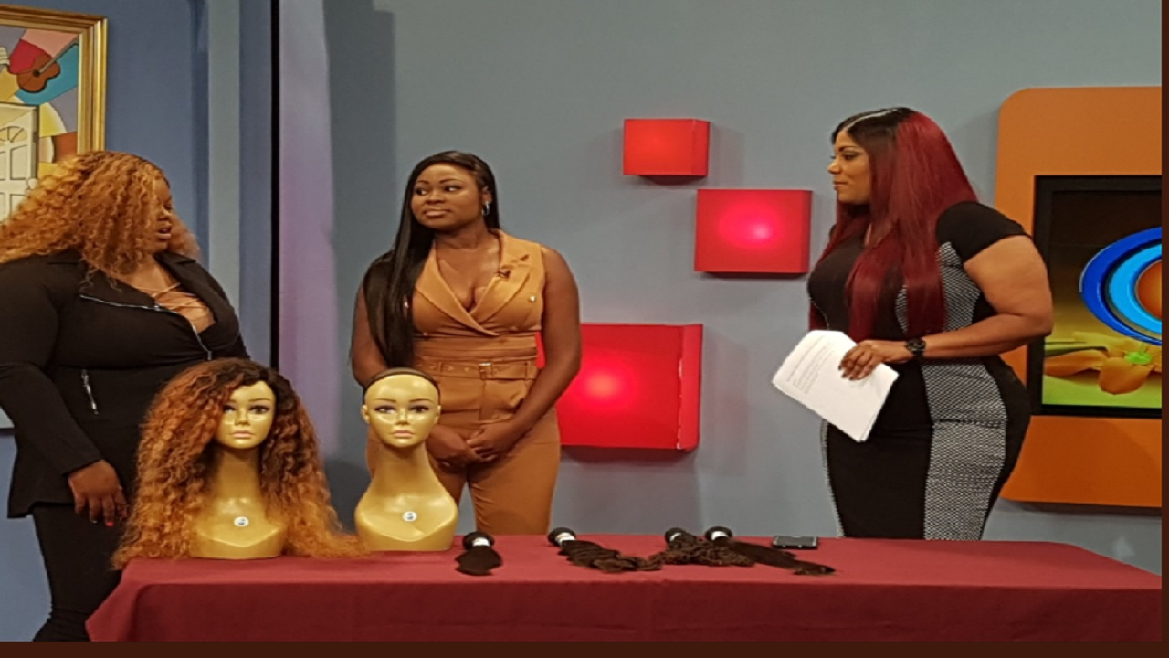(From left) Renae Brackett Biggs, owner of Fentii Couture, with Shenile Simmons, owner of Hair Exquisite, and TVJ's Dahlia Harris during a recent appearance on the television station. (Photo: Twitter)