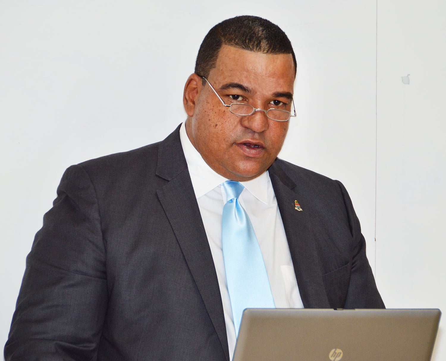 Councillor Mr. Austin Harris addresses a stakeholders meeting at the Chamber of Commerce on the Occupational Wage Survey (OWS) that is to start on 16 October 2017.