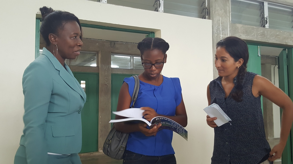 (left) Author and Educator, Annette Maynard-Alleyne chatting with science students as they browse through the newly launched Advanced Level Chemistry for Life (Unit 1) text book by Valerie Moseley after its launch at the Barbados Community College.