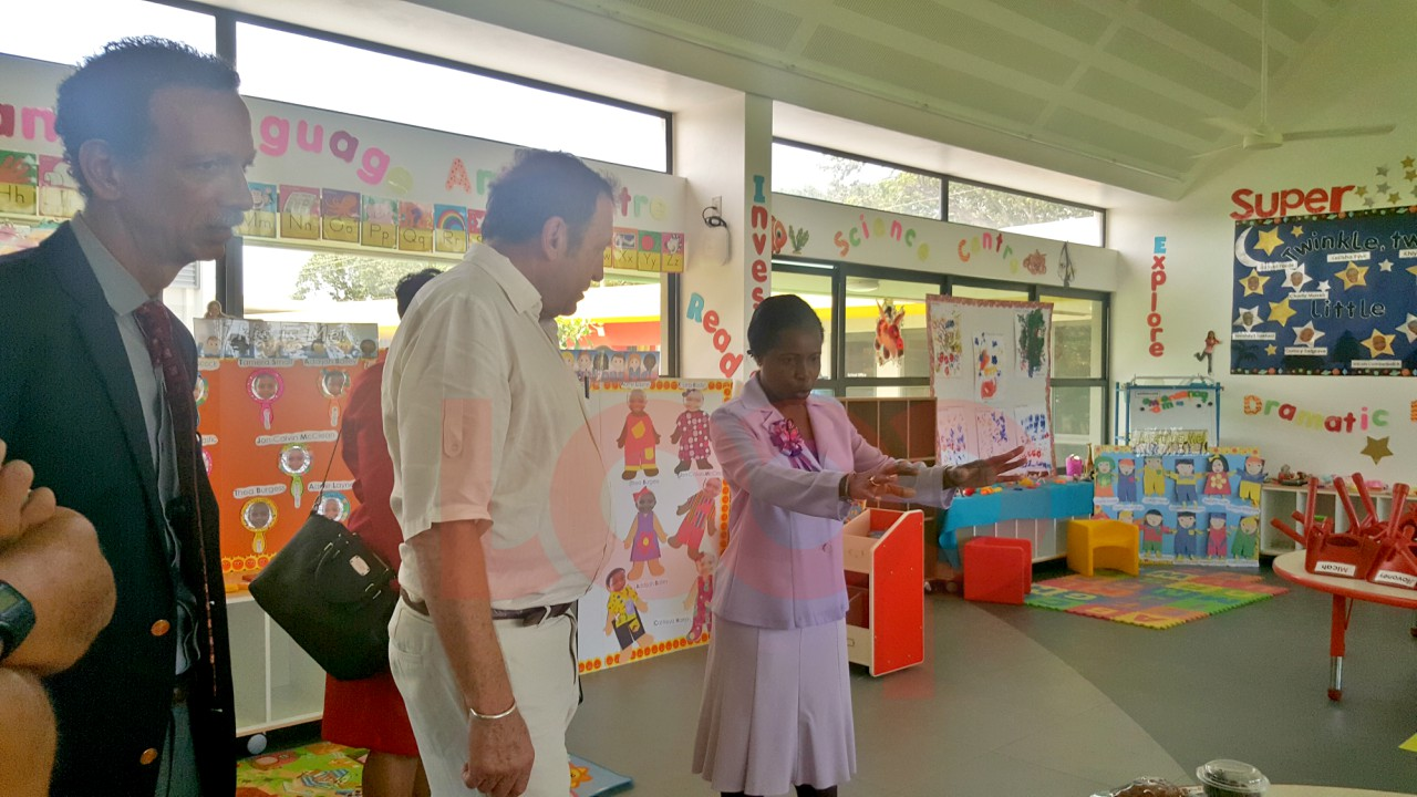 Principal Sharon Knight (right) was taking to Maria Holder Trust Trustee Michael Russell (middle) and other education officials when they conducted a tour of the nursery school.