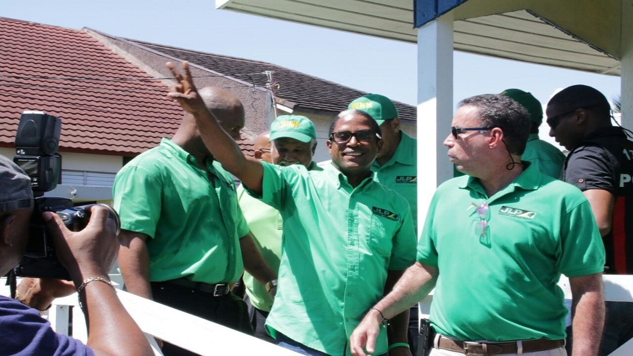 West Portland MP, Daryl Vaz (right) looks on as JLP South East St Mary candidate Dr Norman Dunn greets supporters. (Photo: Llewellyn Wynter)