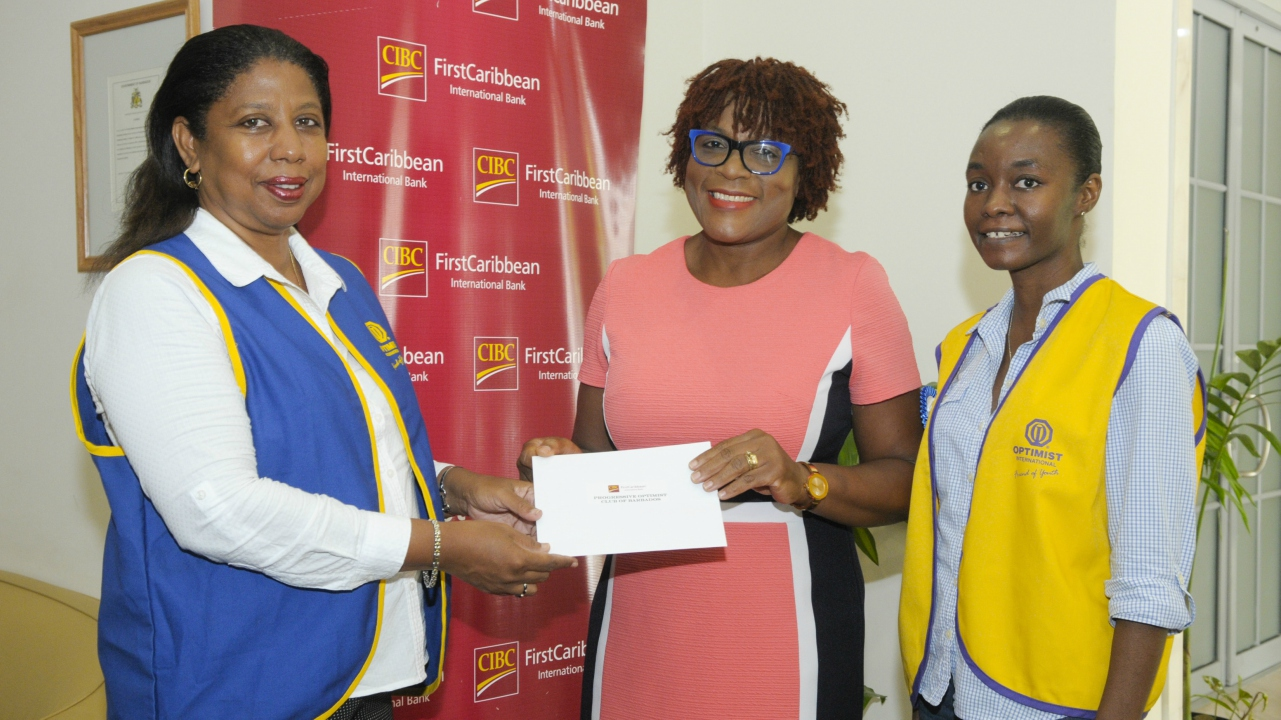 Katherine Farnum, Head of Human Resources (Barbados) CIBC FirstCaribbean (centre), handing over the cheque to club President Designate, Charmaine London (left), as Vice President Paula Manning looks on.
