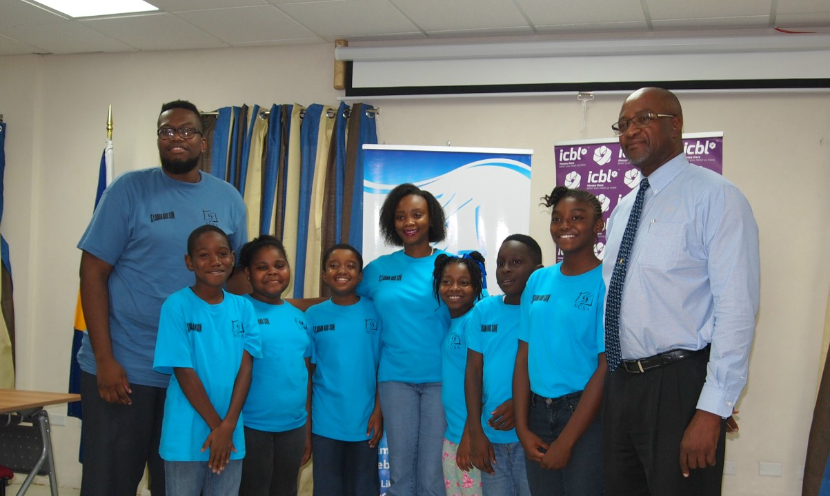 Senior VP at ICBL, Henry Inniss, with the students of Project Soft coordinated by the National Council on Substance Abuse (NCSA). Also pictured is Community Project Officer, Makeda Bourne (centre) and Community Officer, Mosiah Hoyte (left).