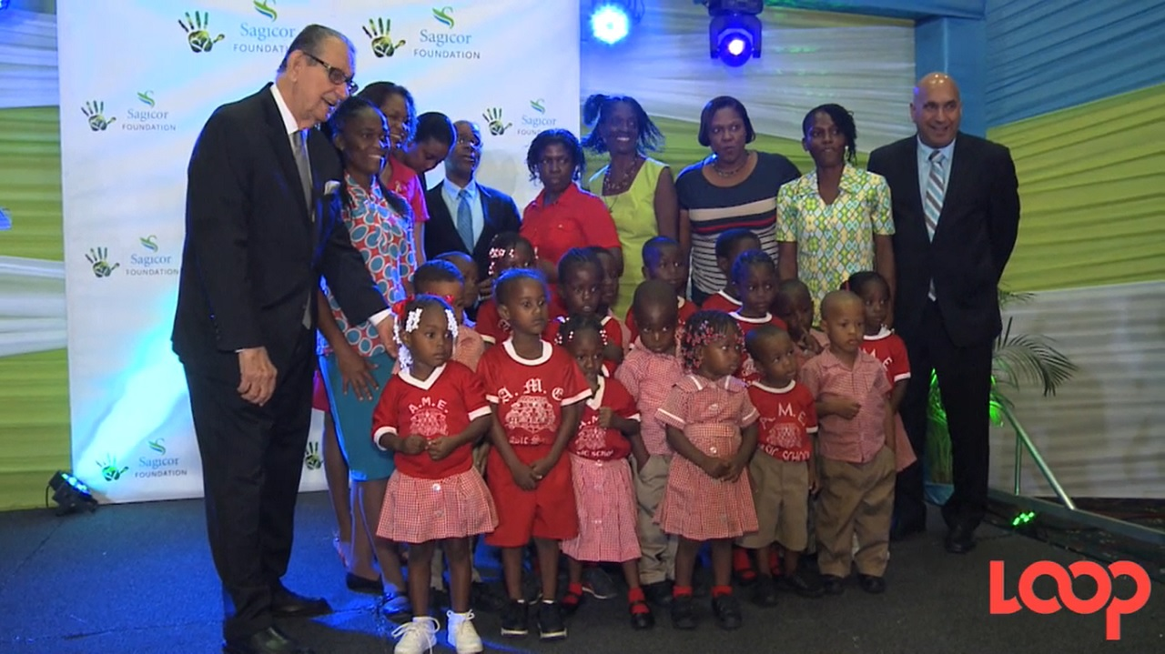 Sagicor Foundation chairman R Danny Williams (left) and Sagicor CEO Christopher Zacca (right) with students at the launch for the Adopt A School Programme 2017.