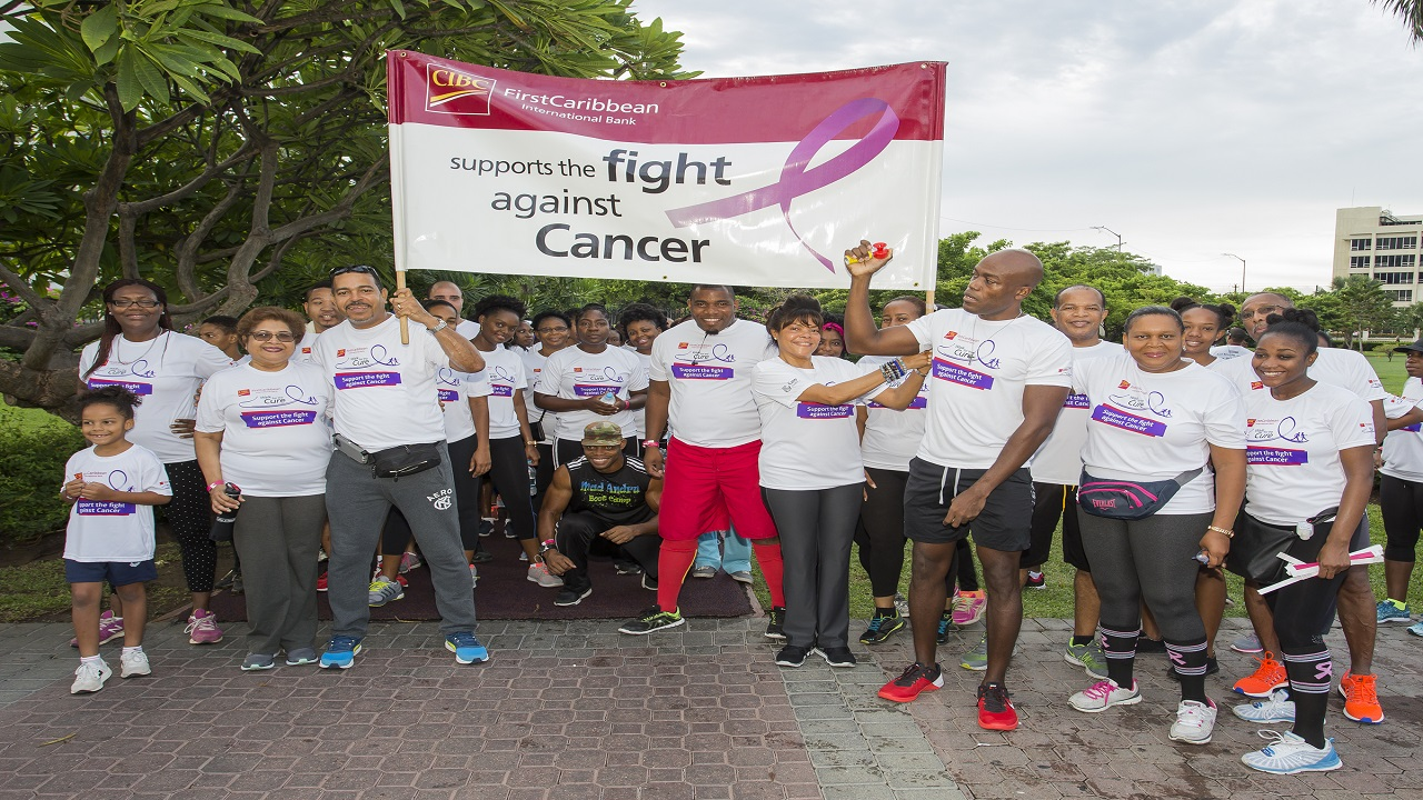 "At the starting line of CIBC FirstCaribbean International Bank's ""Walk For The Cure"" 2017 at Emancipation Park on Sunday: Jean Lowrie Chin (2nd left), Board Director of the bank; Nigel Holness (3rd left), Managing Director of the bank; Yulit Gordon (4th right), Executive Director, Jamaica Cancer Society; Lancelot Leslie (3rd right), Chief Financial Officer of the bank and Jerome Griffith (2nd right),  HR Manager, with team members, friends and family and sponsors representatives."