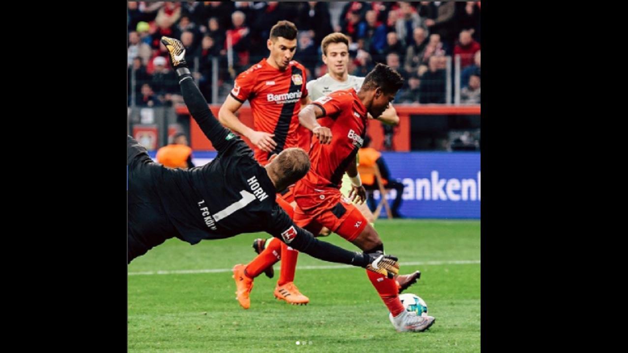 Leon Bailey rounds Cologne goalkeeper Timo Horn to bring Leverkusen level.