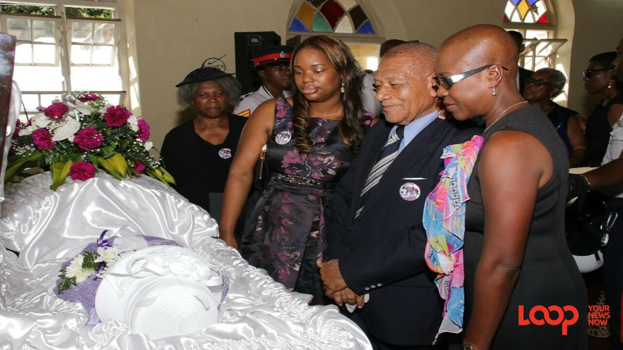 Mourners view the body of Violet Moss Brown at her funeral service on Saturday in Duanvale, Trelawny. (Photos: Llewellyn Wynter)