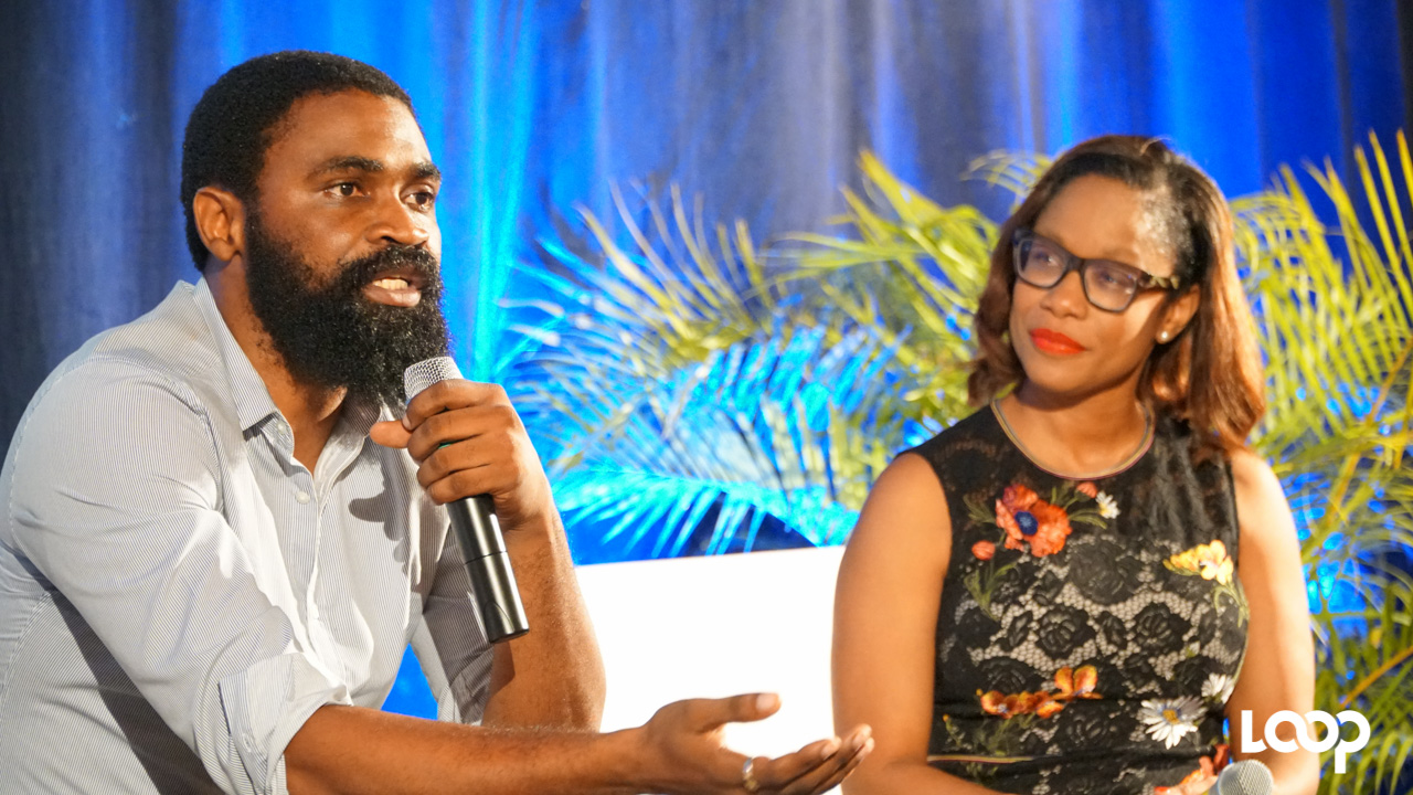 (L-R) Economist and Lecturer in Banking and Finance at the University of the West Indies Cave Hill Campus, Jeremy Stephen, and moderator Lisa Cummins, Executive Director, UWI Consulting. (PHOTO: Richard Grimes)