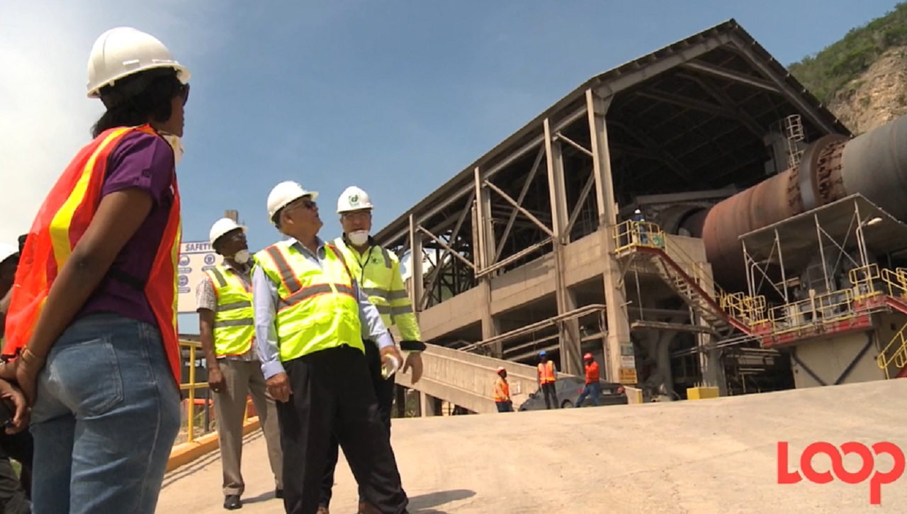 Industry Minister Karl Samuda with Carib Cement executives during a tour of the facility on Wednesday.