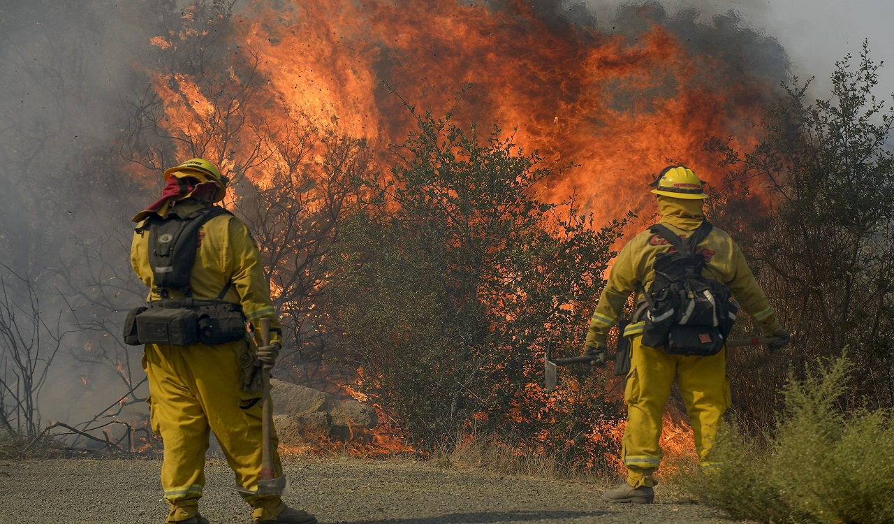 CalFire firefighters protect structures from fires in Sonoma, Calif., on Saturday, Oct. 14, 2017.