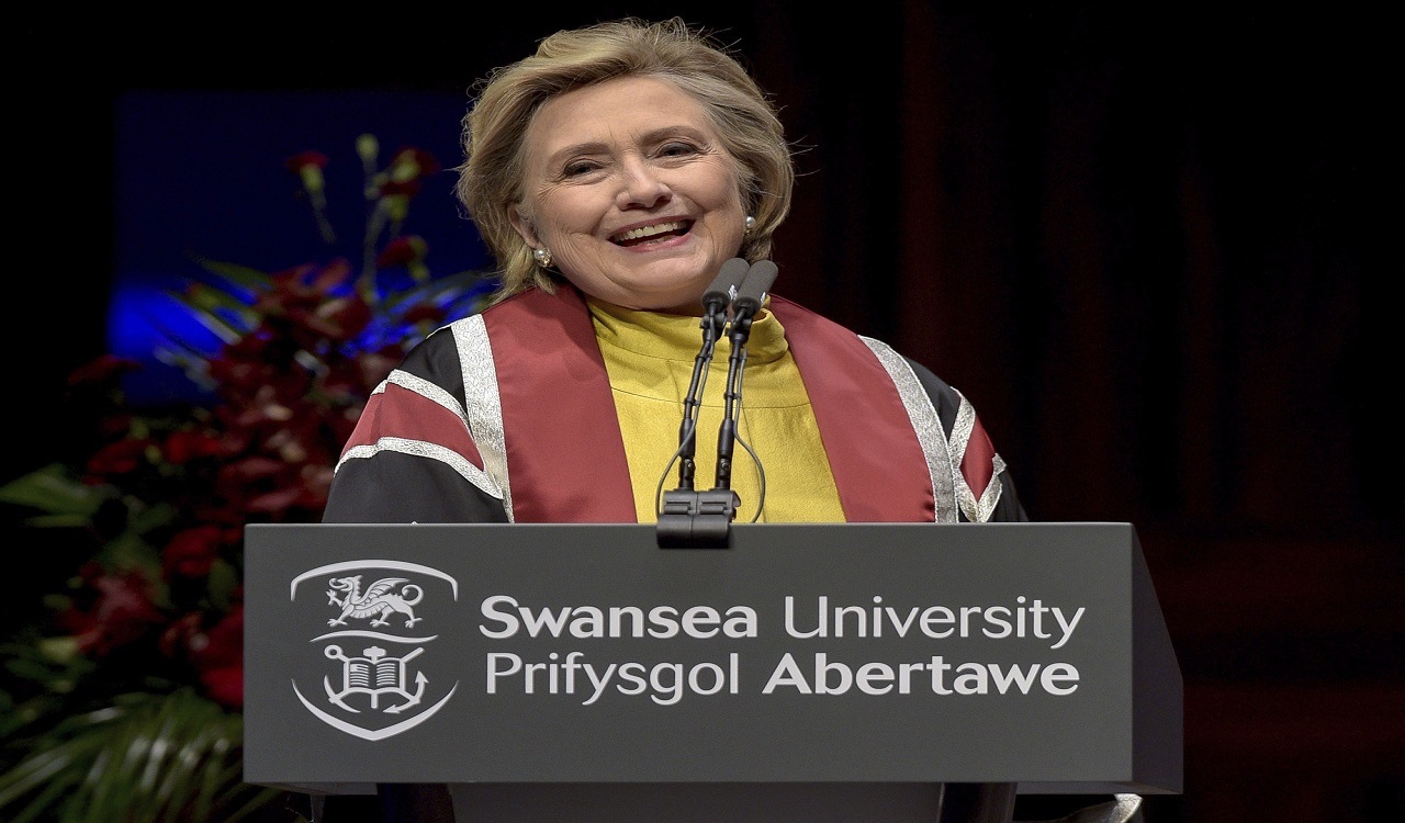 US politician Hillary Rodham Clinton delivers a speech during a ceremony where she received a Honorary Doctorate at Swansea University, in recognition of her commitment to promoting the rights of families and children around the world, in Swansea, Wales, Saturday, Oct. 14, 2017.