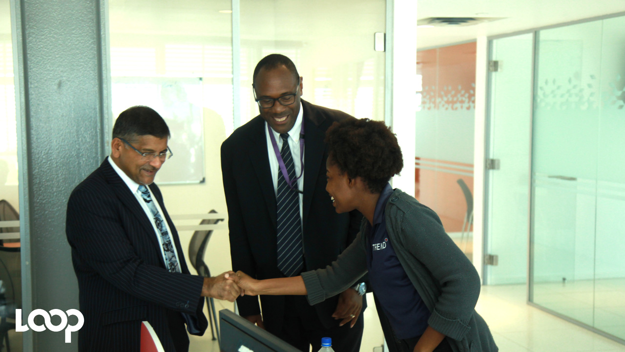 New British High Commissioner Asif Ahmad (left) greets Trend Media Group's Marketing Manager, Sheryl-Ann Thomas-Scott with Loop's Group Executive Editor Al Edwards at a recent visit by Ahmad to Trend Media's office.