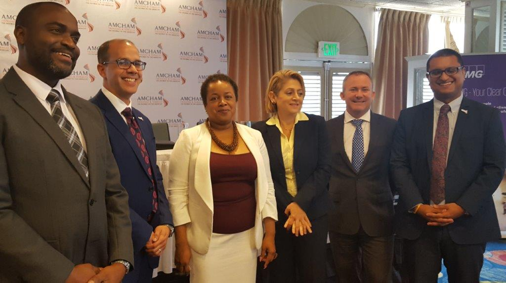 Speakers at the AMCHAM T&T Post Budget Forum pose for a group photo. At centre is Minister in the Ministry of Finance, Allyson West