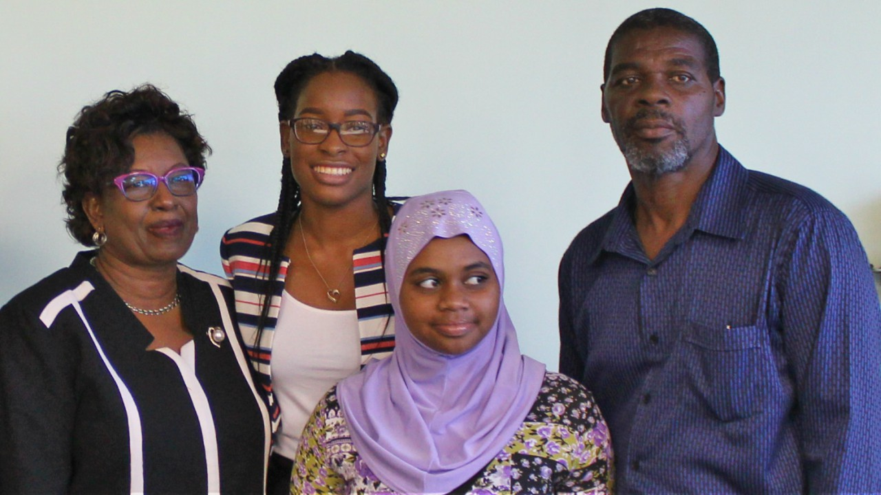 (L-R) Mother of winner of the Optimist International Essay Contest, Magreta Jordan-Watson; winner Akilah Jordan-Watson; friend, Saamiya Cumberbatch; and Akilah's father, Ralpston Watson.