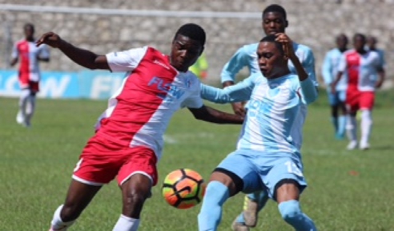 Action from the ISSA/FLOW Manning Cup quarter-final game between St Catherine High and St George's High at Prison Oval in Spanish Town on Tuesday. The game ended in a goalless draw.
