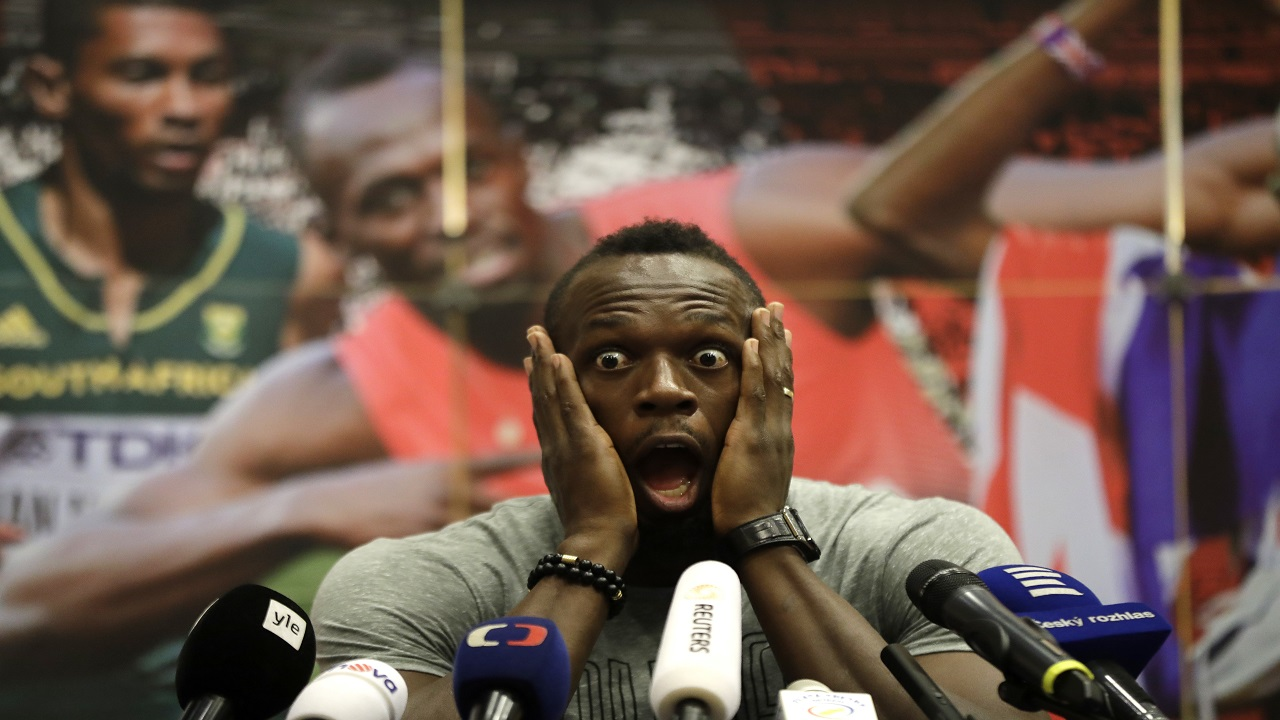 Usain Bolt grimaces during a press conference prior to a track meet earlier this year.