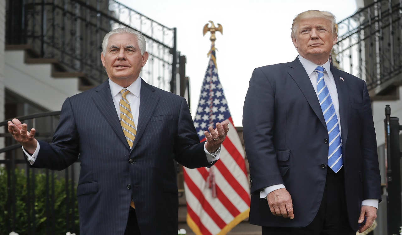 In this Aug. 11, 2017, file photo, Secretary of State Rex Tillerson, left, speaks following a meeting with President Donald Trump at Trump National Golf Club in Bedminster, N.J.