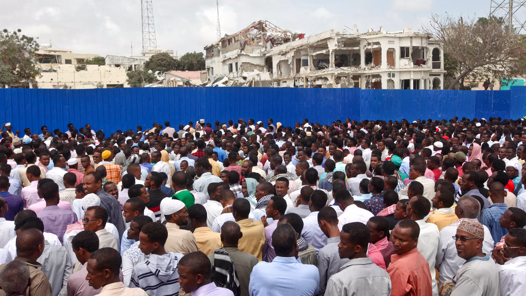 Thousands of Somalis gather to pray at the site of the country's deadliest attack and to mourn the hundreds of victims, at the site of the attack in Mogadishu, Somalia Friday, Oct. 20. More than 300 people were killed and nearly 400 wounded in Saturday's truck bombing, with scores missing.