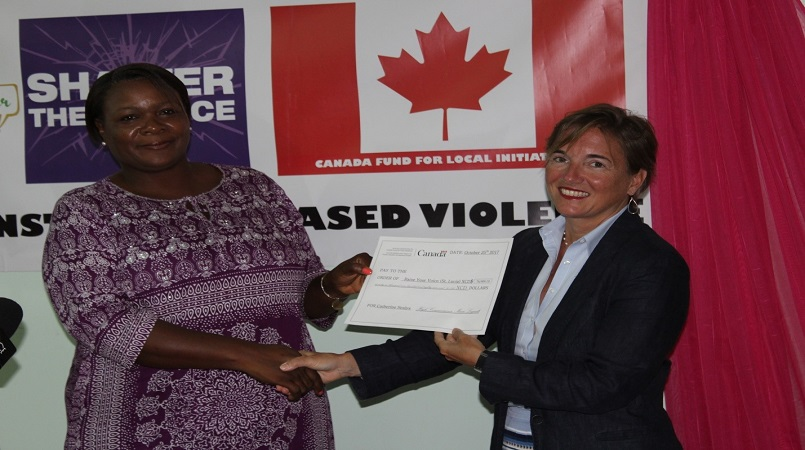 Handing over the EC$76,000 grant to Raise Your Voice Saint Lucia Inc's Catherine Sealys (left) is Canada's High Commissioner to Barbados and the Eastern Caribbean HE Marie Lagault.