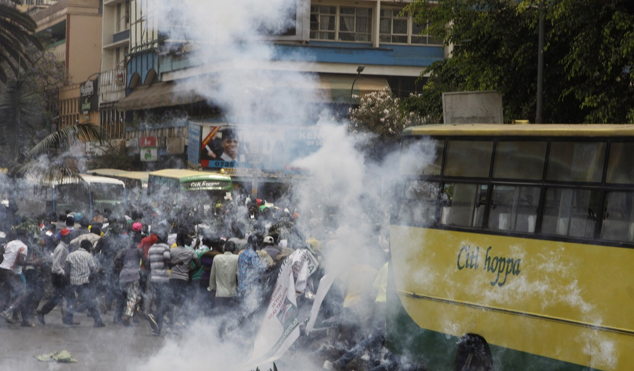 Riot police fire teargas against opposition supporters during a demonstration against the Independent Electoral and Boundaries Commission (IEBC) in Nairobi, Kenya, Wednesday, Oct. 11, 2017.