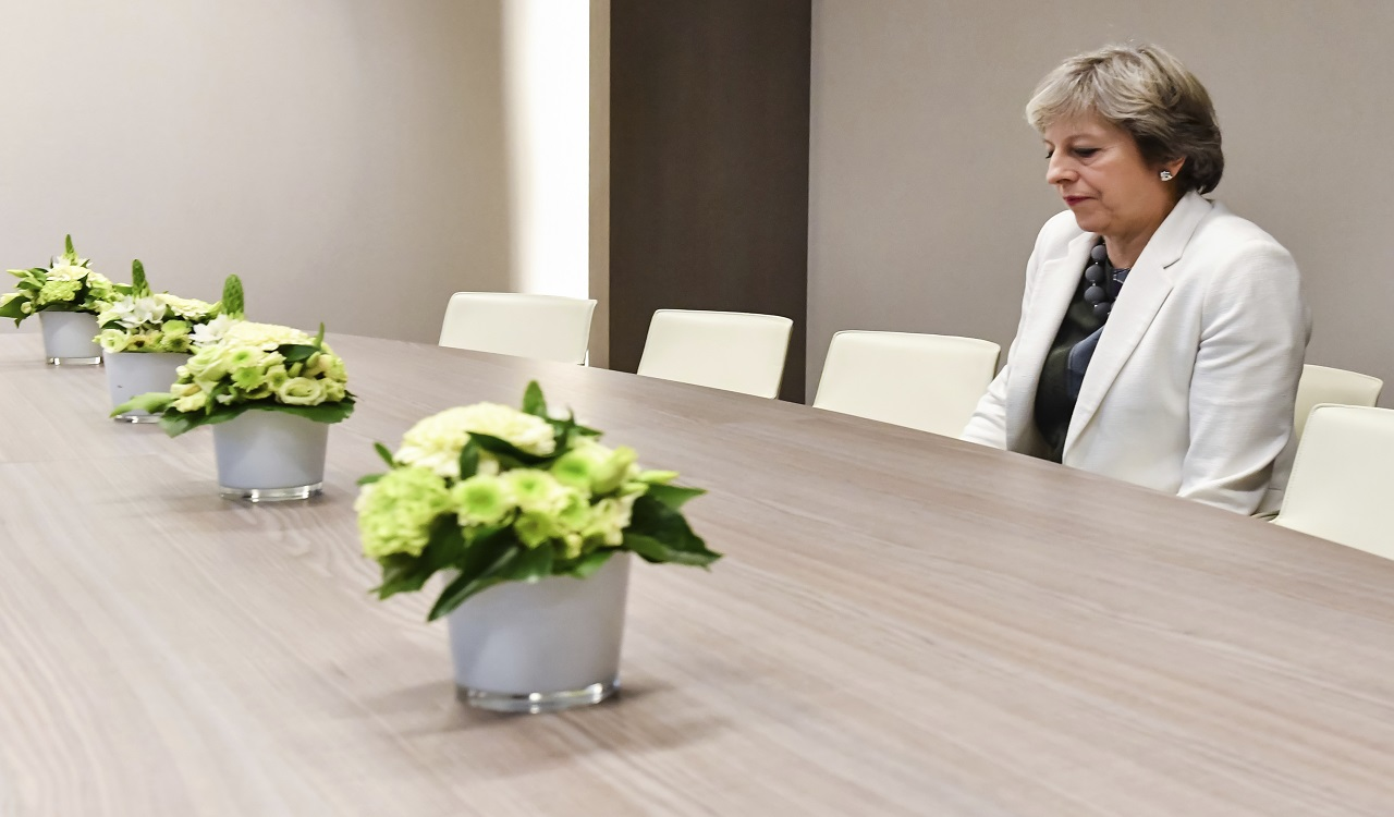 British Prime Minister Theresa May waits for the arrival of European Council President Donald Tusk prior to a bilateral meeting with European Council President Donald Tusk during an EU summit in Brussels on Friday, Oct. 20, 2017.