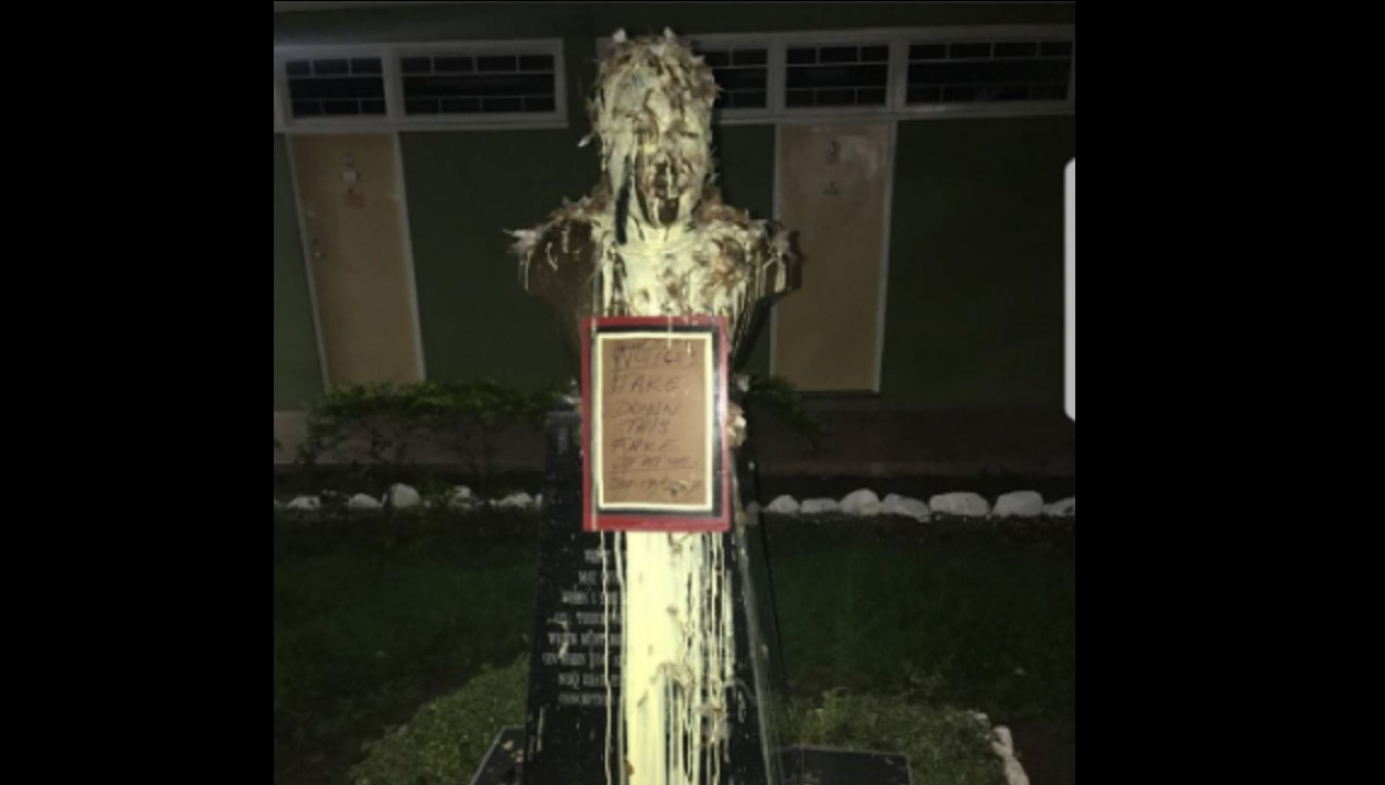 Photo of defaced Marcus Garvey bust circulating on social media.