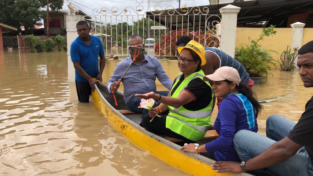 Opposition Leader Kamla Persad-Bissessar, TV Personality Ian Alleyne tour Siparia during floods.
