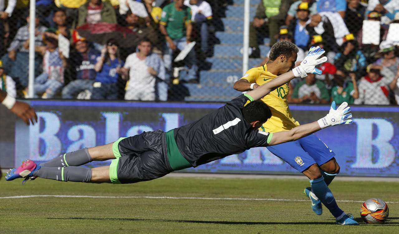 Bolivia goalkeeper Carlos Lampe, left, blocks a shot from Brazil's Neymar during a World Cup qualifying football match in La Paz, Bolivia, Thursday, Oct. 5 2017.