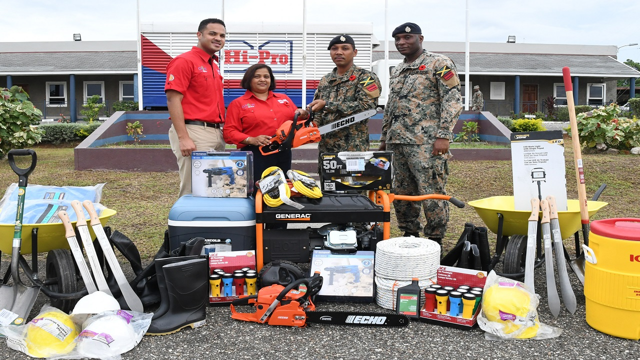 Tricia Jackson (second left), Operations Manager, Hi-Pro Farm Supplies Store, holds one of the many items donated by Hi-Pro to the Jamaica Defence Force contingent to Dominica.  Accepting on behalf of the JDF are Lieutenant Colonel Mahatma Williams (second right) Commanding Officer 1, Engineer Regiment and Regiment Sergeant Major Hecton Stone (right). Looking on at left is Dayne Patterson, Business Development Manager, Hi-Pro.