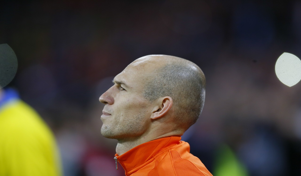 Netherland's Arjen Robben stands during the national anthem prior to the start of a World Cup Group A football qualifying match between the Netherlands and Sweden in Amsterdam, Netherlands, Tuesday, Oct. 10, 2017.