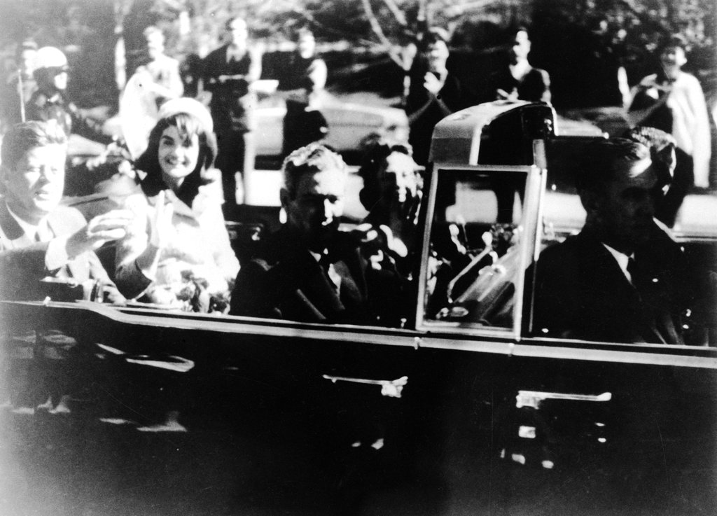 President JFK at the extreme right on rear seat of his limousine during Dallas, motorcade on Nov. 22, 1963. His wife, Jacqueline, beside him, Gov. John Connally of Texas and his wife were on jump seats in front of the president.