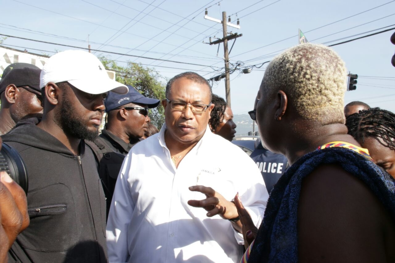 Member of Parliament for Western St Andrew Anthony Hylton speaks with residents of Seaview Gardens.