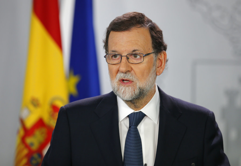 Spain's Prime Minister Mariano Rajoy speaks during a press conference at the Moncloa Palace in Madrid, Spain, Wednesday, Oct. 11, 2017. The Spanish Cabinet met in Madrid Wednesday to work out its response to an announcement from the head of the wealthy Catalonia region that he was proceeding with a declaration of independence, further fueling Spain's worst political crisis in decades. (AP Photo/Paul White)