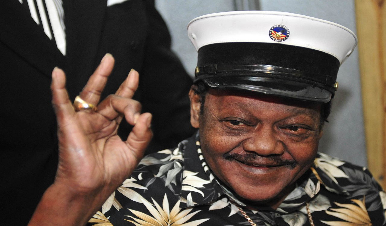 In this Nov. 5, 2008 file photo, Fats Domino waves to fans before a ceremony re-presenting two Grammy awards to replace the ones that he lost from Hurricane Katrina's flooding in New Orleans. Domino, the amiable rock 'n' roll pioneer whose steady, pounding piano and easy baritone helped change popular music even as it honored the grand, good-humored tradition of the Crescent City, has died.