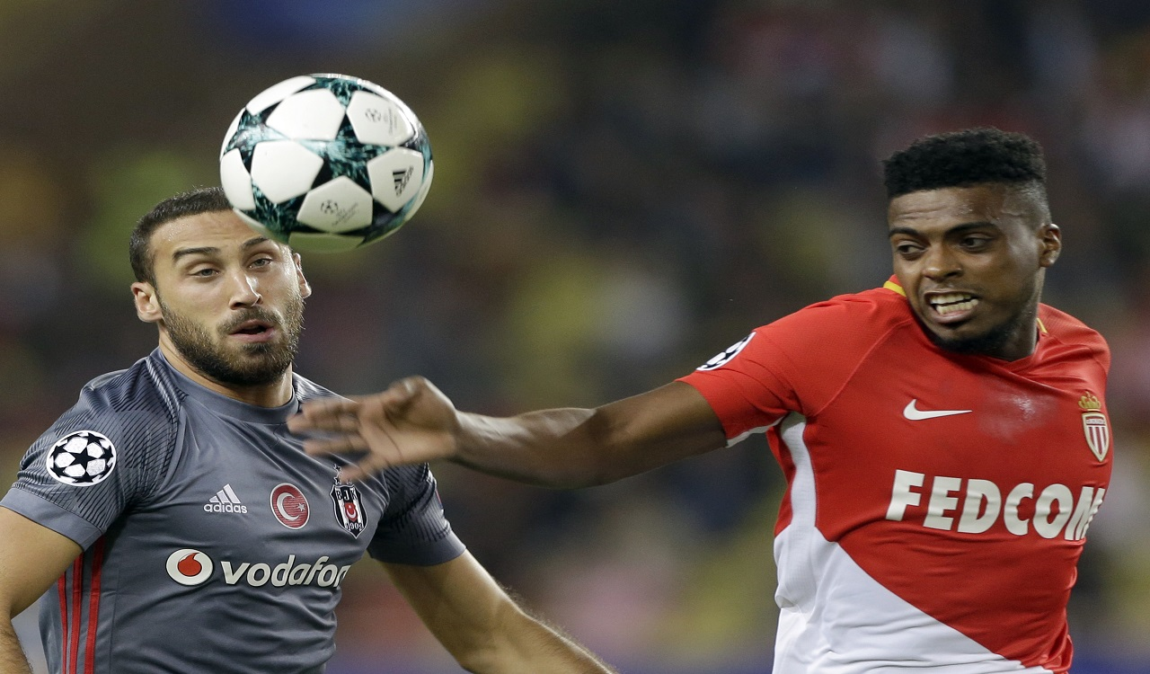 Besiktas' Cenk Tosun, left, challenges for the ball with Monaco's Jemerson during the Champions League Group G first leg football match against Monaco at Louis II stadium in Monaco, Tuesday, Oct. 17, 2017.