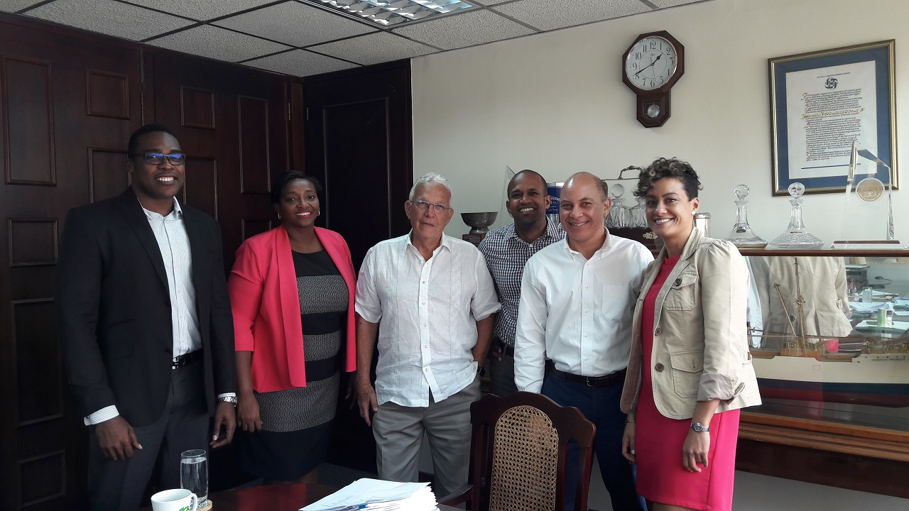 The team that pulled together the Jamaica Producers Group $1.5 billion Offer. In picture are Jamaica Producers Executives, Charles Johnson (3rd left) and Jeffrey Hall (2nd right) and Simone Pearson (right) joined by Gregory Samuels (left) Sygnus Capital Ltd and Lead Arranger team at Scotia Investment Karene Blair (2nd Right) and Dylan Coke (3rd Left).