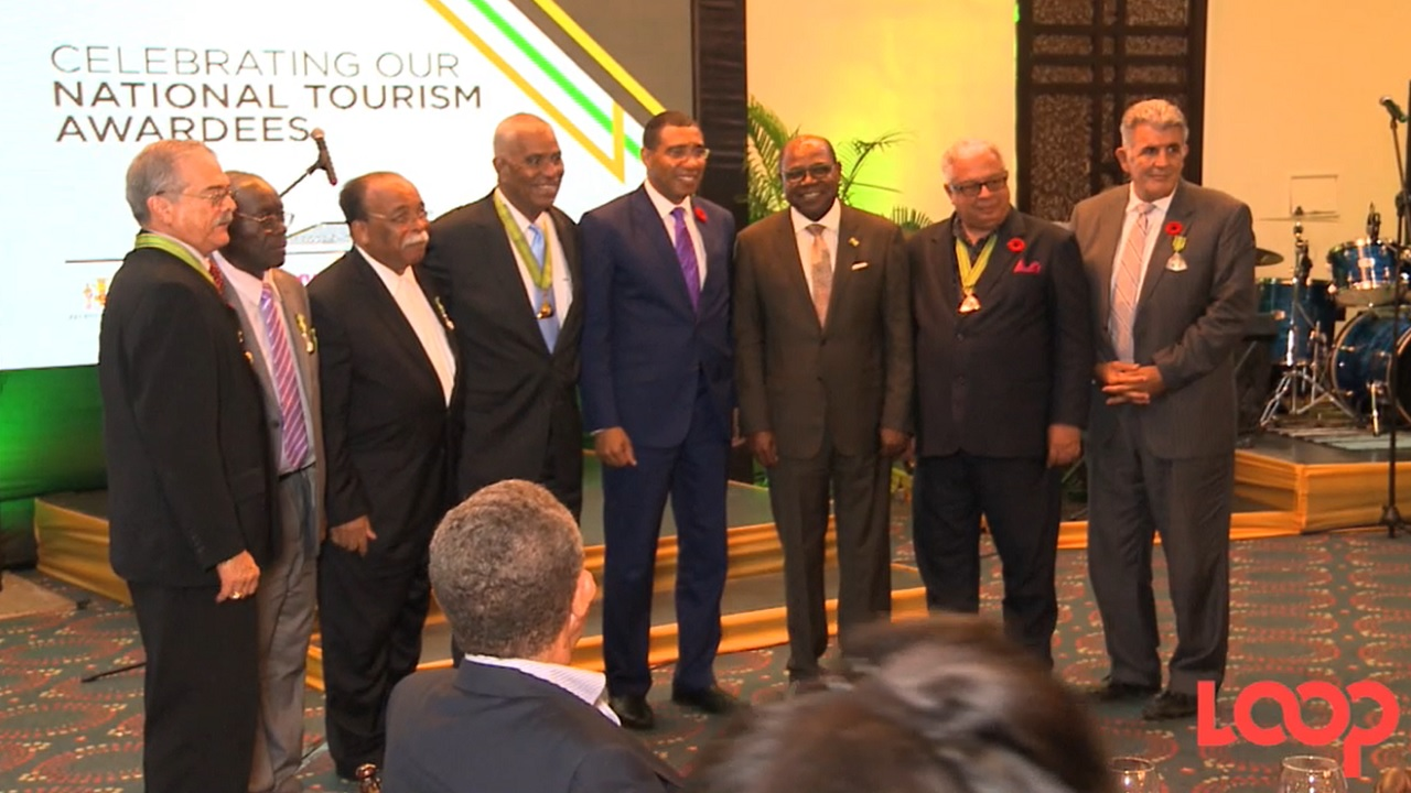 The 2017 national honourees from the Tourism sector with Prime Minister Andrew Holness and Tourism Minister Ed Bartlett.