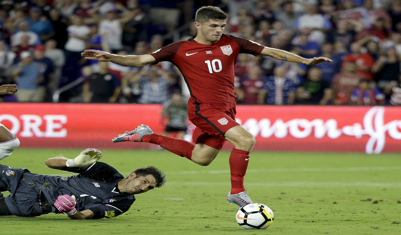United States' Christian Pulisic (10) gets past Panama goalkeeper Jaime Penedo (1) to score a goal during the first half of a World Cup qualifying football match, Friday, Oct. 6, 2017, in Orlando, Fla.