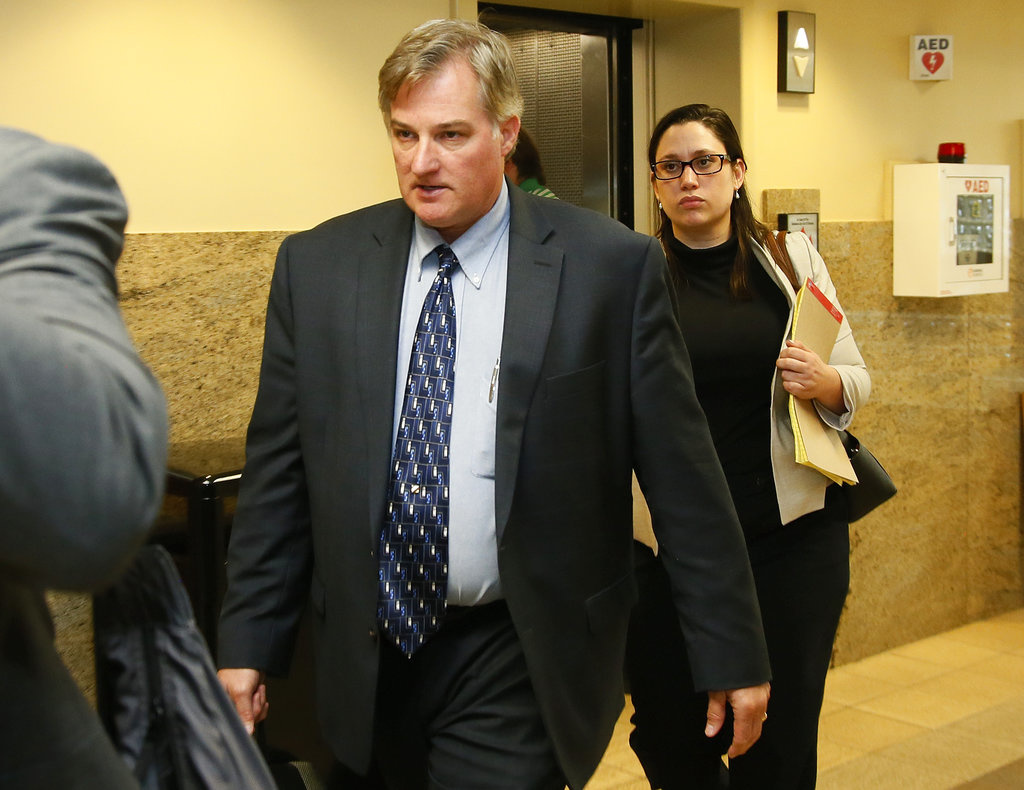 In this June 30, 2017 file photo, ex-Tulsa police officer Shannon Kepler, left, arrives with his legal team for afternoon testimony in his third trial in Tulsa, Okla. Jurors in the fourth murder trial for Kepler, a white former Oklahoma police officer, heard a 911 call Tuesday, Oct. 17, 2017 where his daughter screams to dispatchers that her father had shot her 19-year-old black boyfriend. (AP Photo/Sue Ogrocki, File)