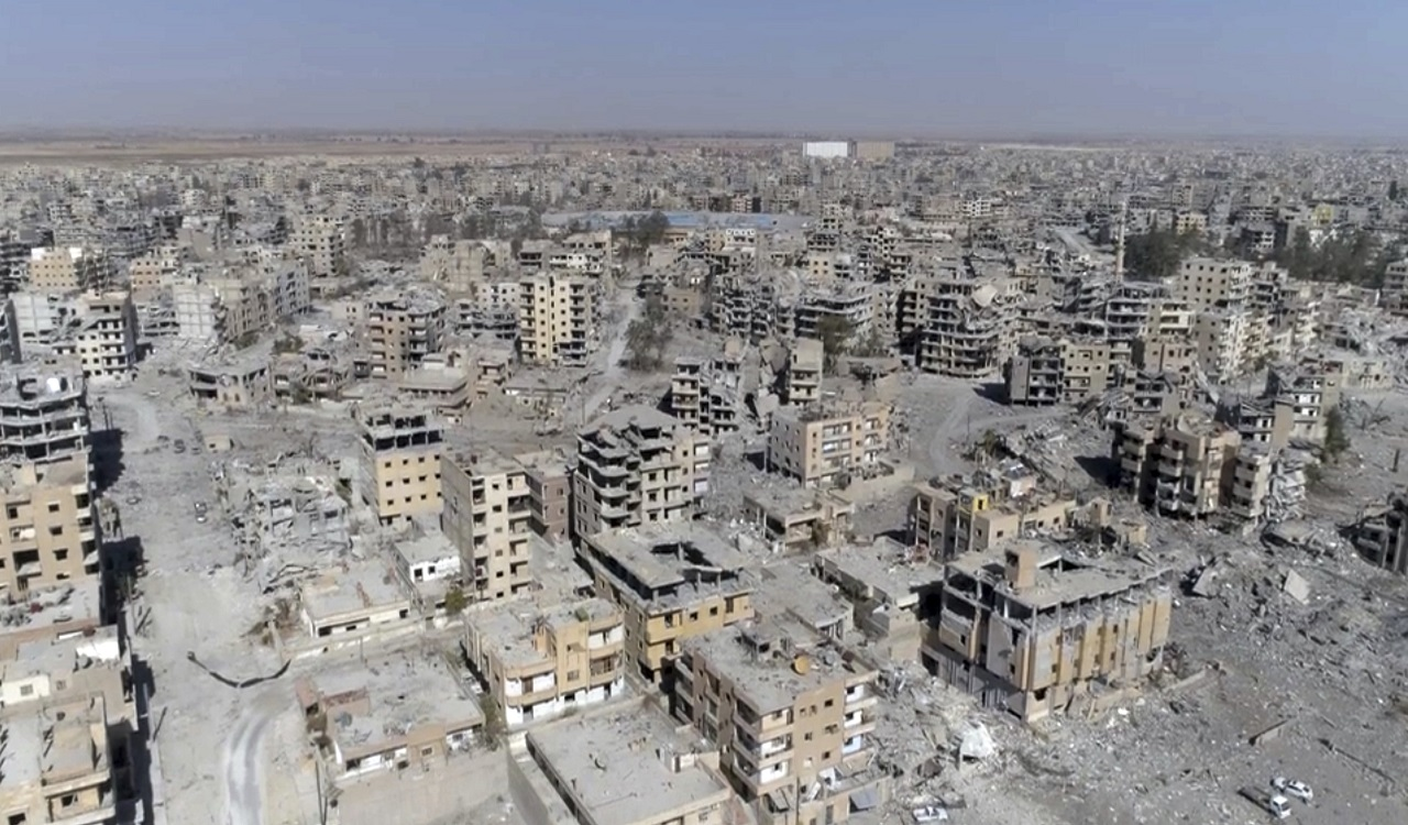 This Thursday, Oct. 19, 2017 frame grab made from drone video shows damaged buildings in Raqqa, Syria two days after Syrian Democratic Forces said that military operations to oust the Islamic State group have ended and that their fighters have taken full control of the city.