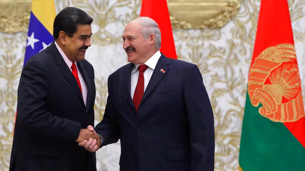Venezuela's President Nicolas Maduro, left, and Belarus' President Alexander Lukashenko greet each during their meeting in Minsk, Belarus, Thursday, Oct. 5, 2017. (AP Photo/Sergei Grits, Pool)