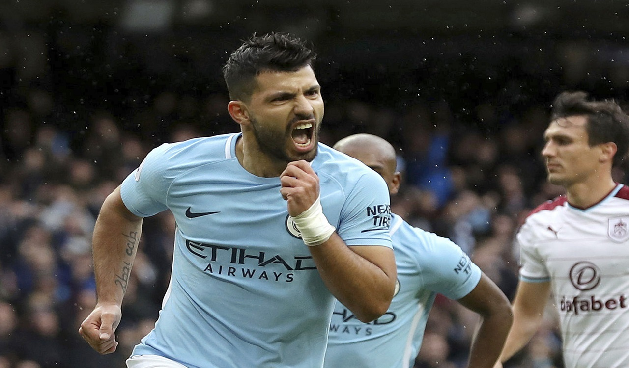 Manchester City's Sergio Aguero celebrates scoring his side's first goal from the penalty spot, equaling Manchester City's all-time scoring record, during the English Premier League  match against Burnley, at the Etihad Stadium, in Manchester, England, Saturday, Oct. 21, 2017.
