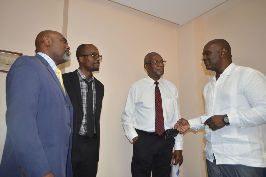 Ambassador Dr. Clarence Henry (right) in discussion with BHTA CEO Rudy Grant (left), BIBA's Henderson Holmes (second from right) and BCCI's Carlos Wharton (second from left)