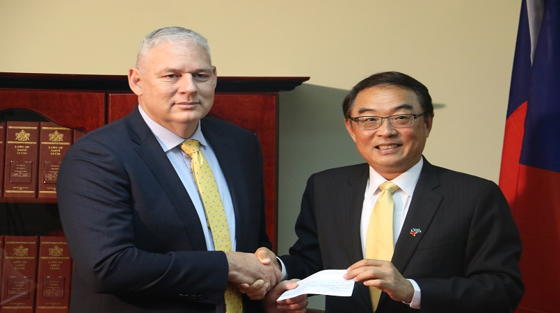Honourable Prime Minister Allen Chastanet (l) with His Excellency Douglas Shen (r)