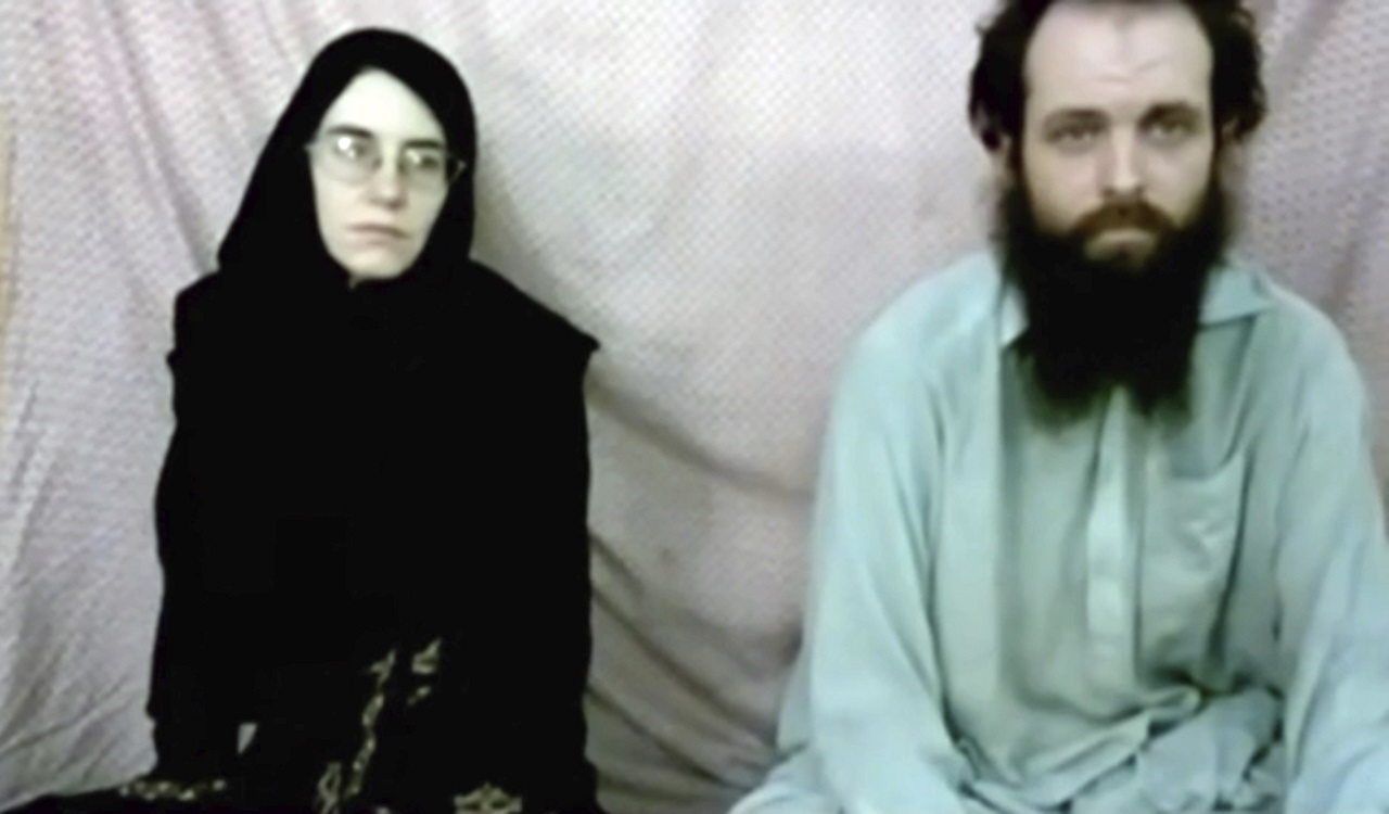 This still image made from a 2013 video released by the Coleman family shows Caitlan Coleman and her husband, Canadian Joshua Boyle in a militant video given to the family.