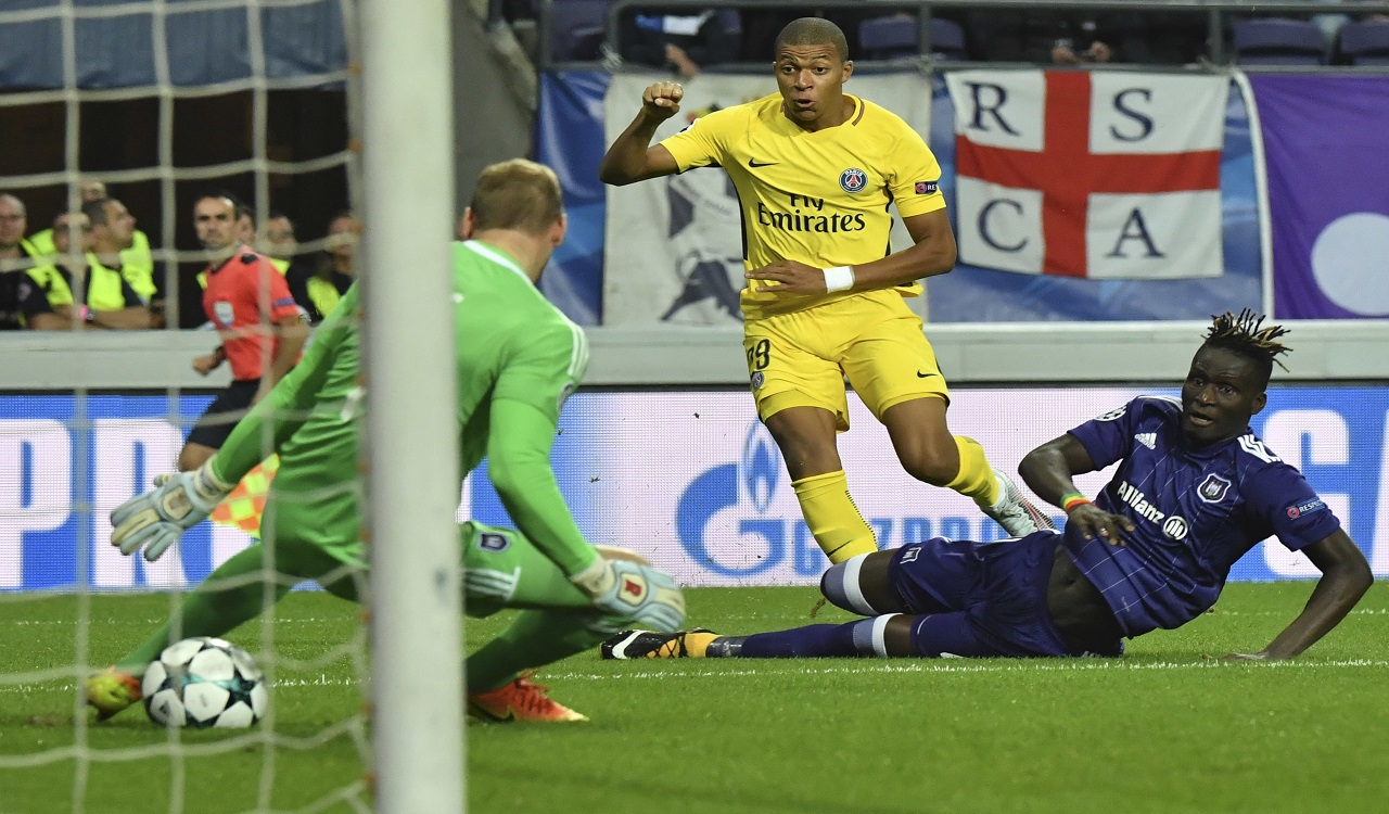 PSG's Kylian Mbappe, center, scores his side's first goal passing Anderlecht goalkeeper Matz Sels, left, and Anderlecht's Kara Mbodji, right, during their Champions League Group B match at the Constant Vanden Stock stadium in Brussels, Belgium, Wednesday, Oct. 18, 2017.