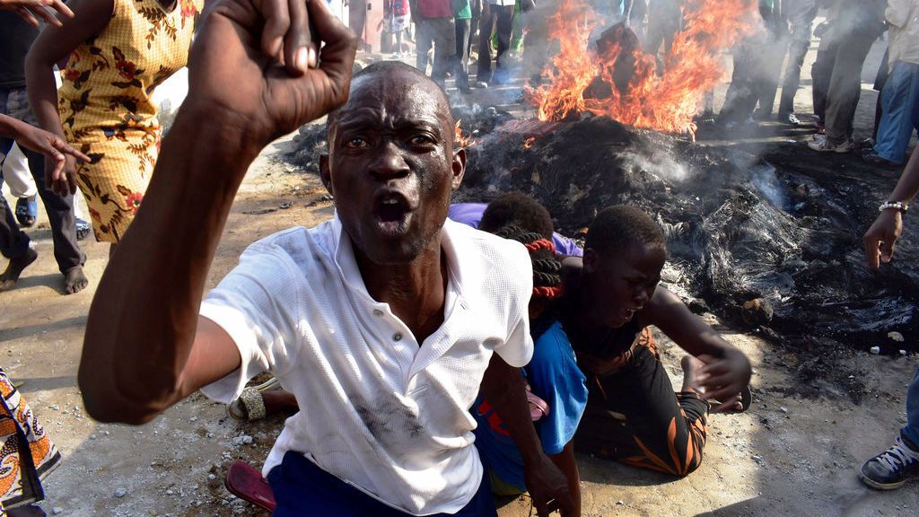 A opposition supporter reacts after burning tyres during demonstrations in Mombasa, Kenya, Thursday, Oct. 26, 2017. Kenya is holding the rerun of its disputed presidential election Thursday, despite a boycott by the main opposition party and rising political tensions in the East African country. (AP Photo)