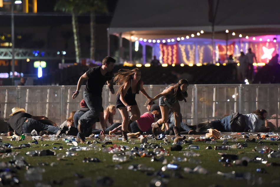 Festivaliers en fuite. David Becker, Getty Images/AFP