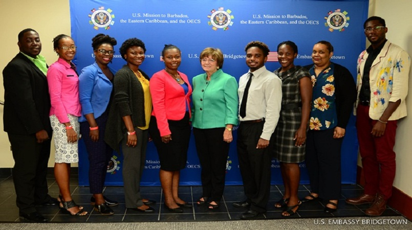 Lucian particpants Michelle Samuel (second from left) and Sacha Harris (fourth from left) pose with U.S. Ambassador to Barbados, the Eastern Caribbean, and the OECS Linda S. Taglialatela (center) and other participants