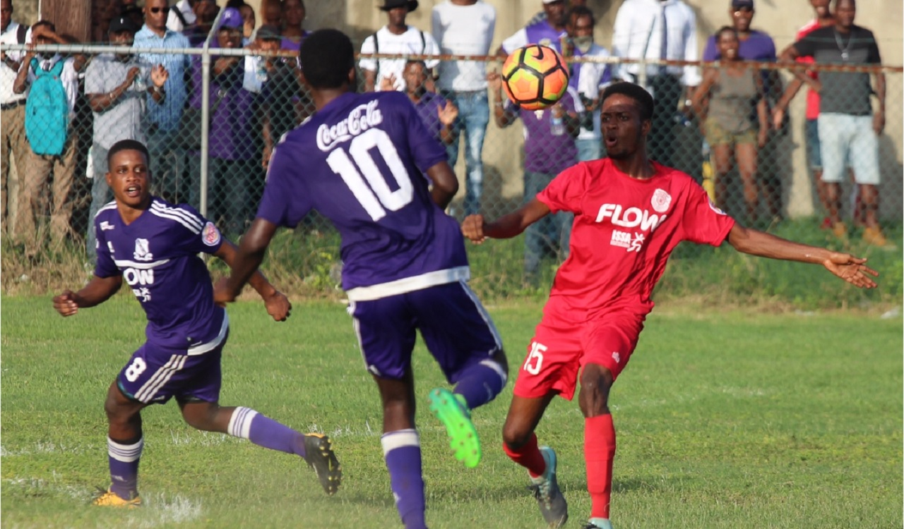 Action from the ISSA/FLOW Manning Cup quarter-final mgame between Kingston College and Bridgeport High at Prison Oval on Tuesday. KC won 3-0.